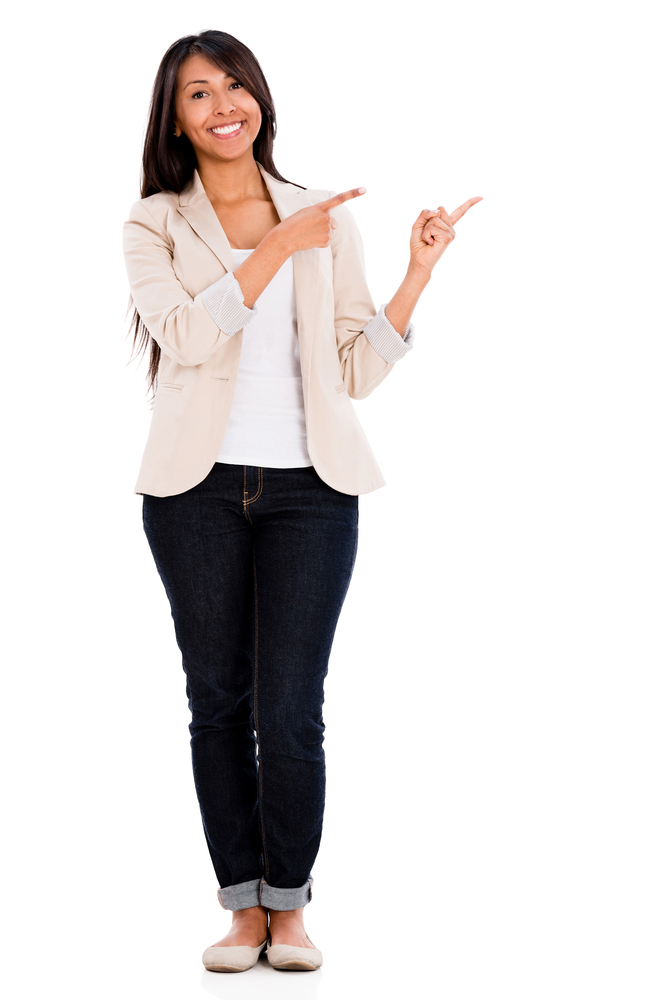 Casual woman pointing to the side - isolated over a white background