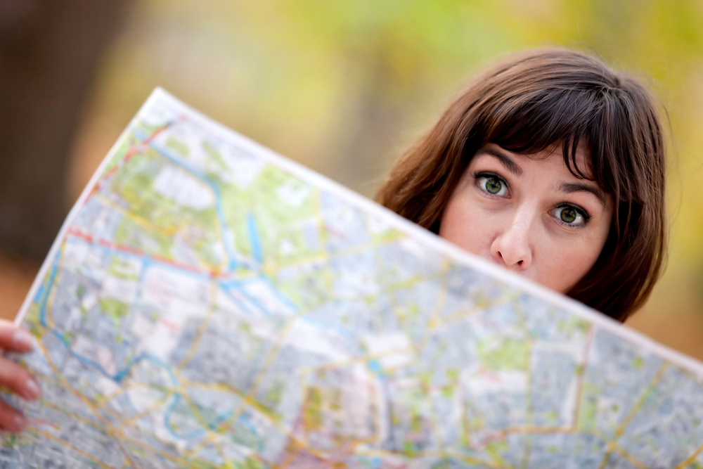 Lost woman holding a map